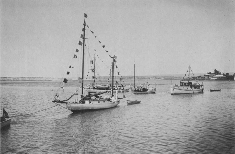 Newport Harbor Yacht Club's boats dress ship for the Fourth of July 1921