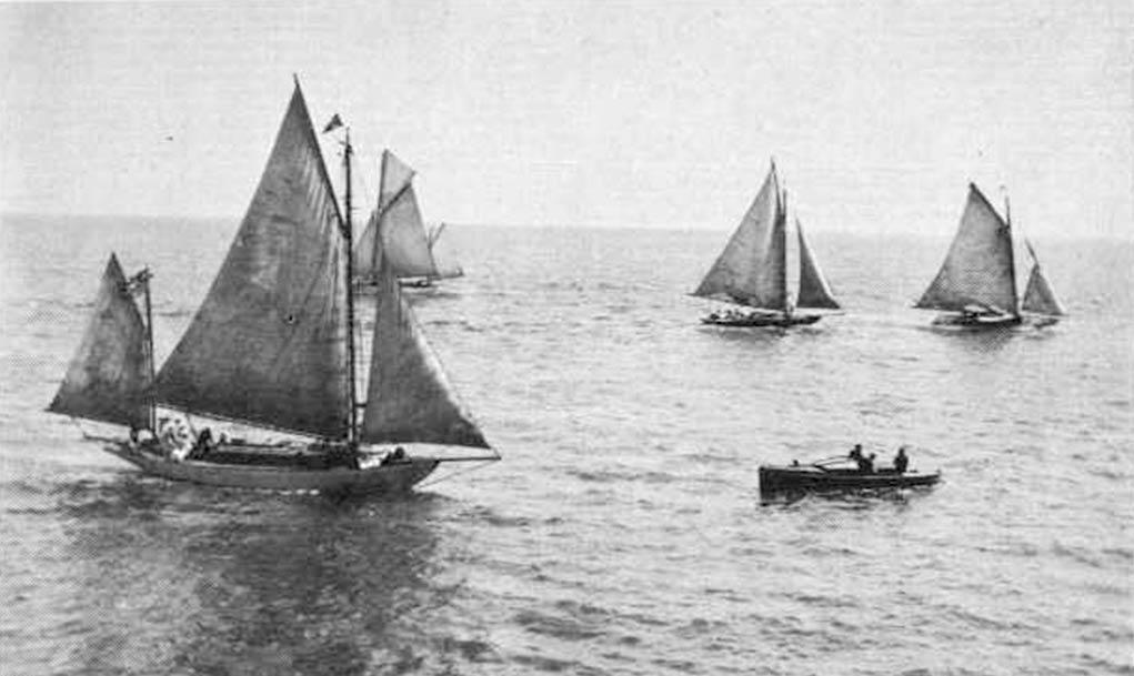 4 gaff rigged sailboats starting a race