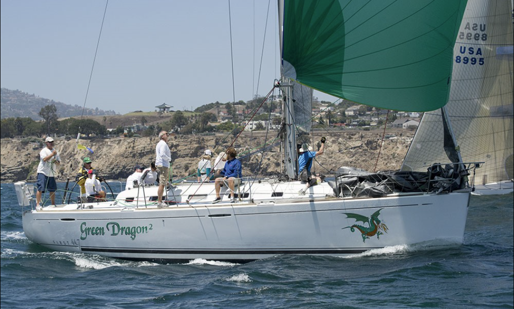 Sailboat Green Dragon racing with spinnaker flyine