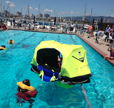 pool and yellow life raft floating
